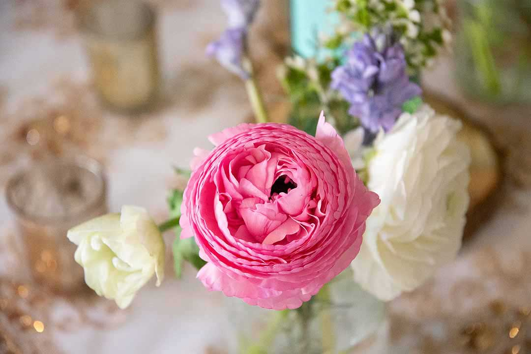 pink, white and blue flowers on a table
