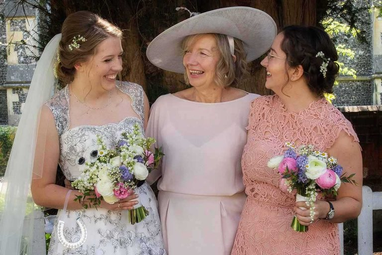 bride with her mum and sister carrying bouquets
