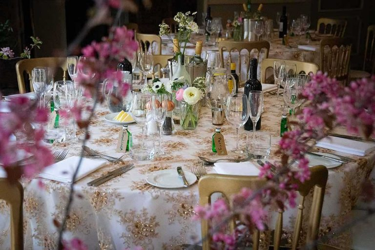 wedding breakfast table with pink blossom