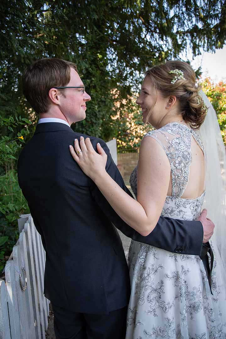 bride and groom with arms around each other
