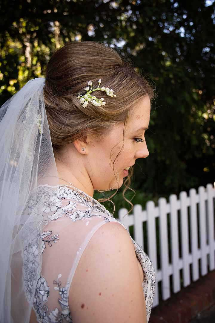 tiny white flowers in blonde bride's hair with veil