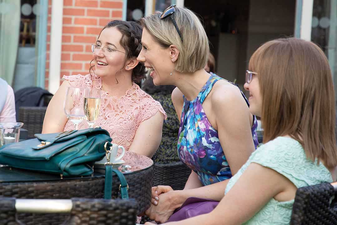 women laughing around a table