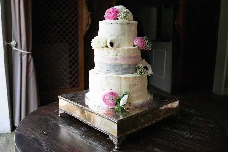 three tier wedding cake with pink and white flowers