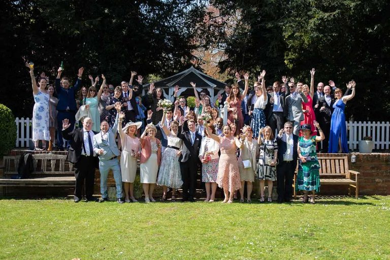 wedding group photo in a sunny garden