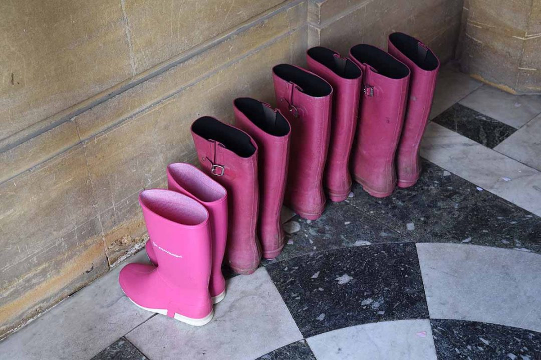 pink wellies on a white and black tiled floor