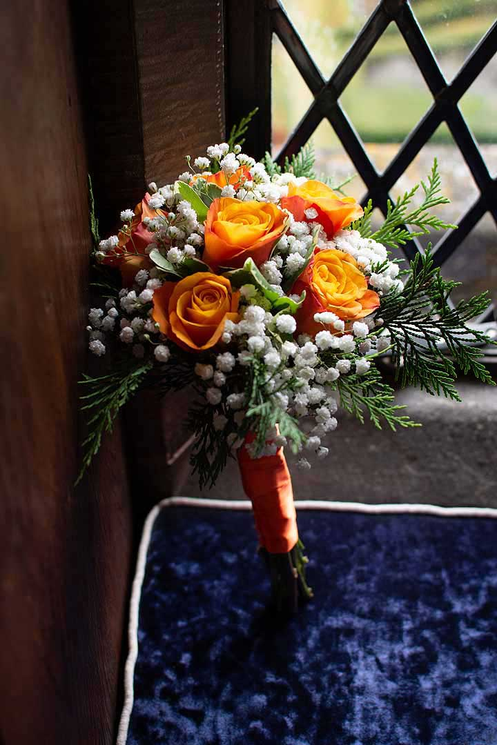 orange rose and white gypsophila bouquet