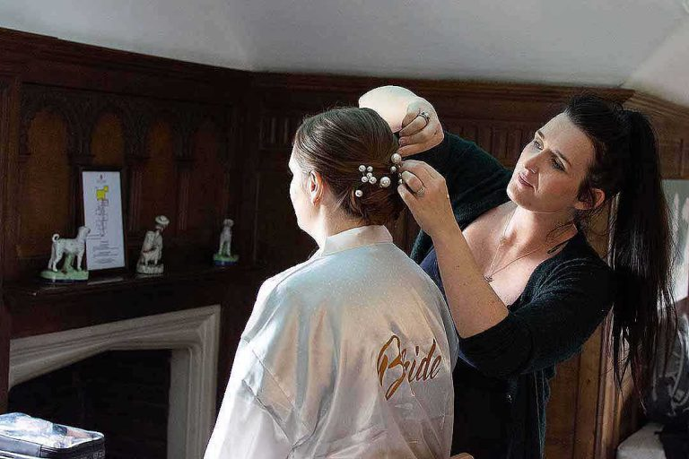 bride having her hair pinned into place