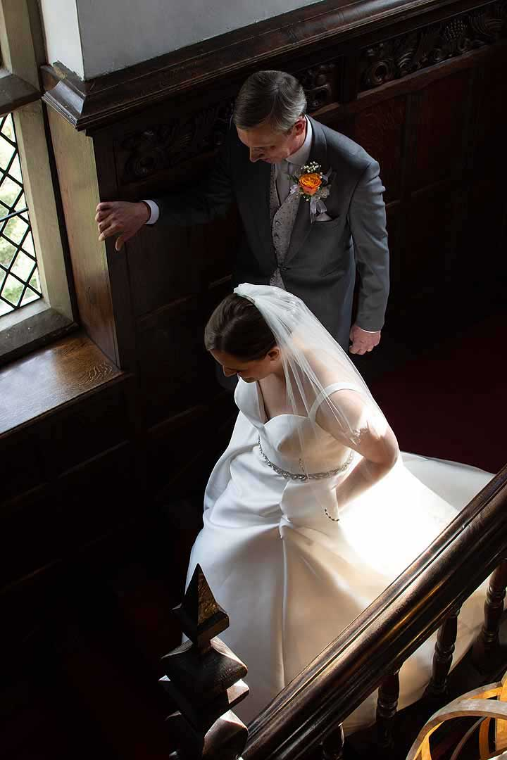 bride and her father going down the stairs