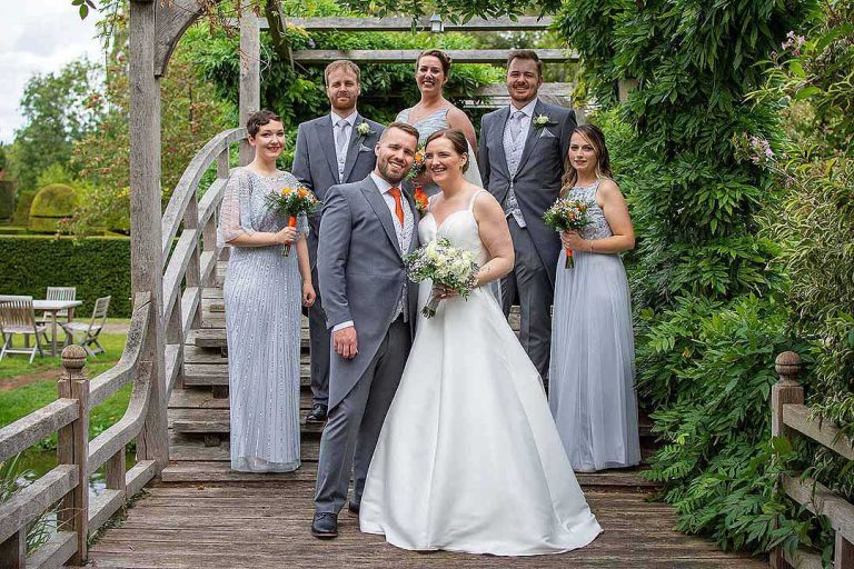 bride and groom with bridesmaids and best men