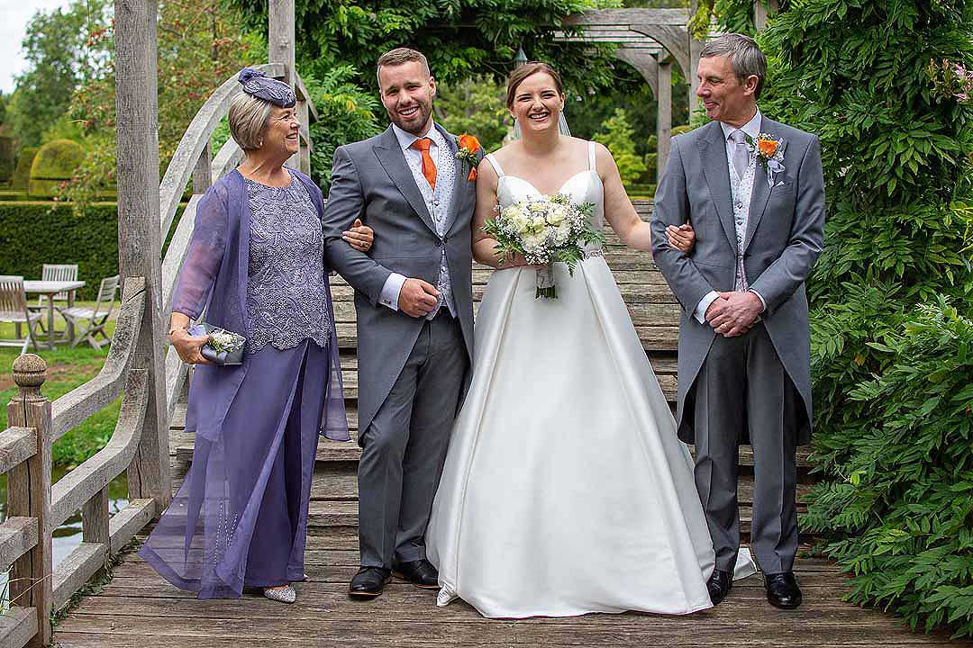bride and groom with her parents