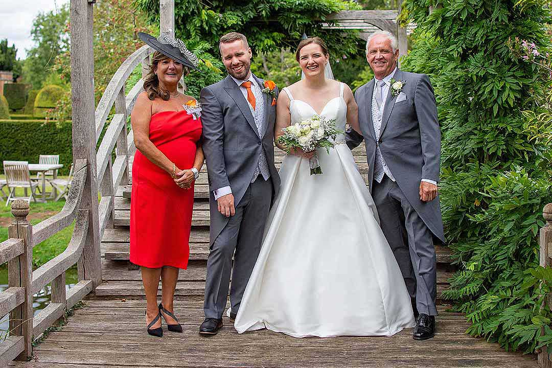 bride and groom with his parents