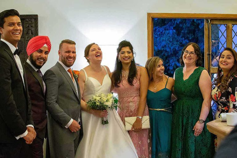 bride, groom and their friends in a line