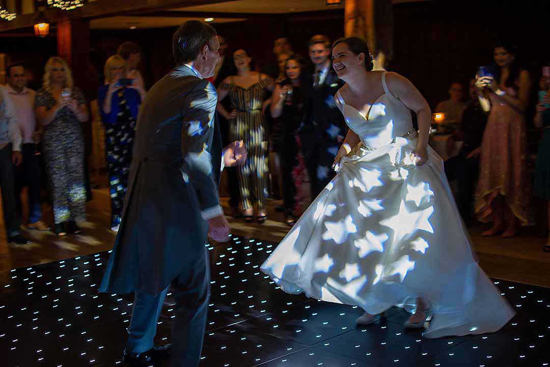 father and daughter dancing on the star light dance floor