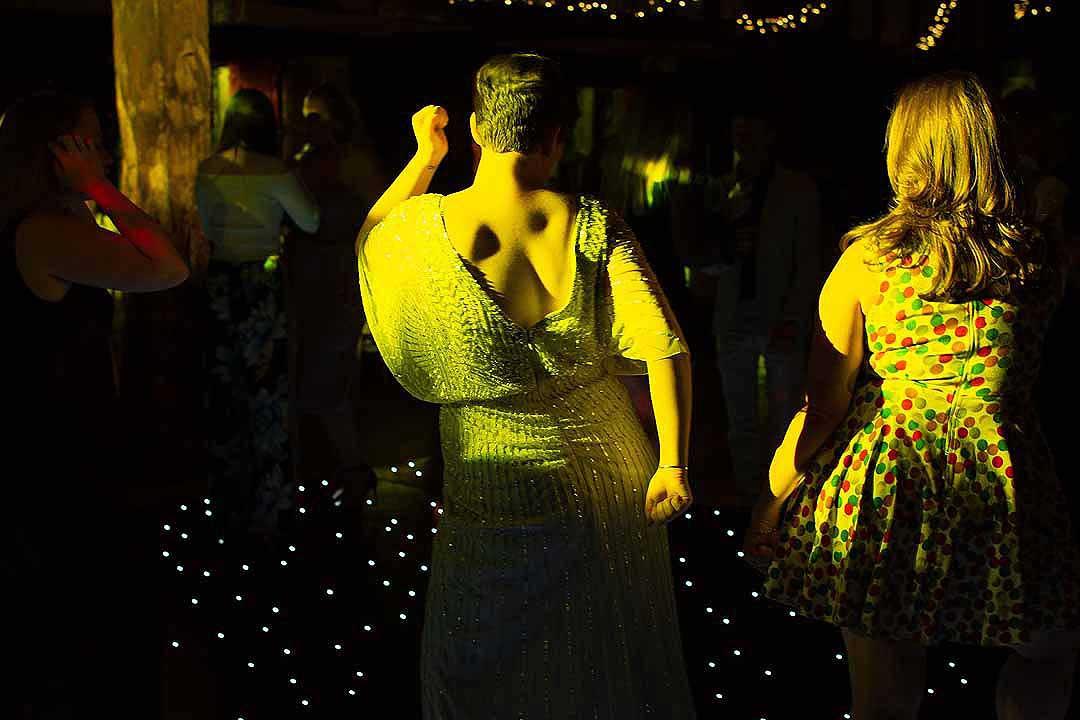 women dancing in yellow light