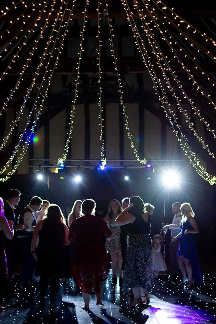 people dancing under the fairy lights