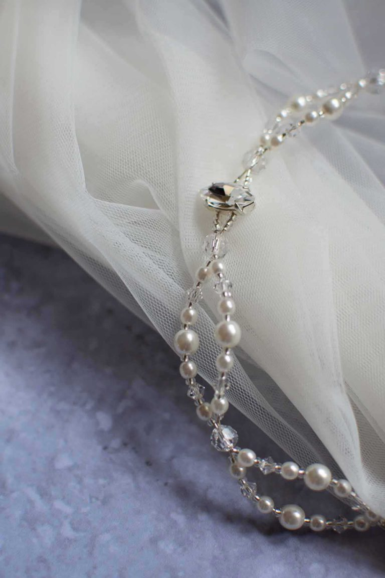 pearl and diamante hair accessory on top of veil