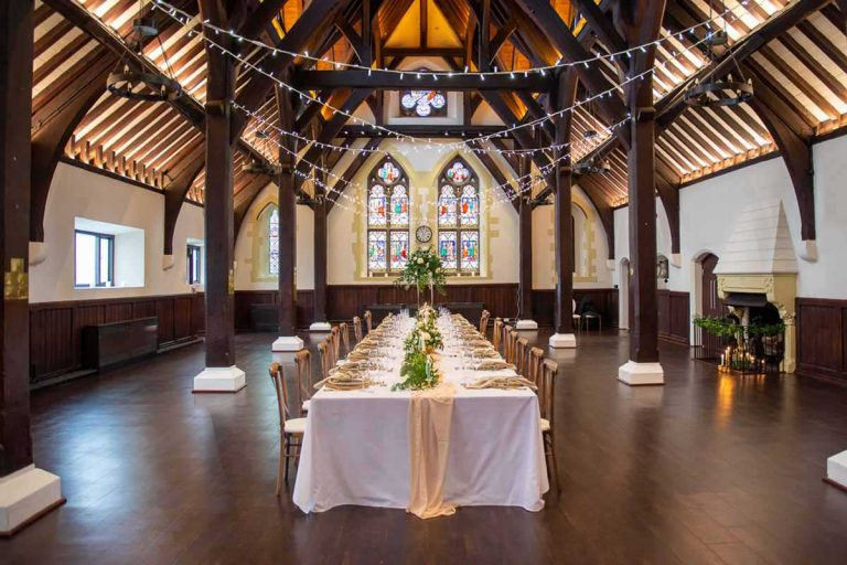 the dining hall at Bradfield College set for a wedding