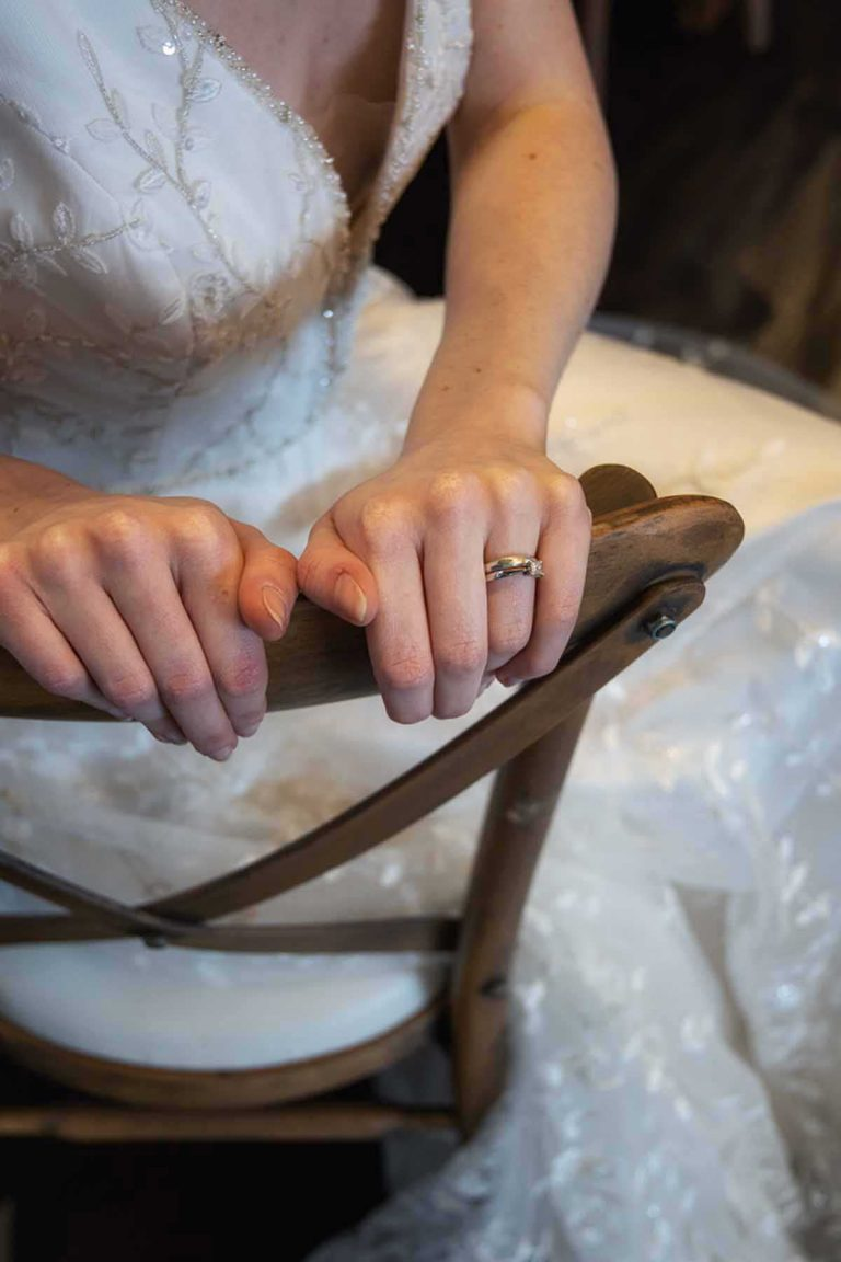 wedding ring and dress details
