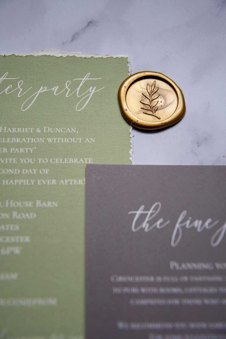 gold wax seal and green and gold stationery
