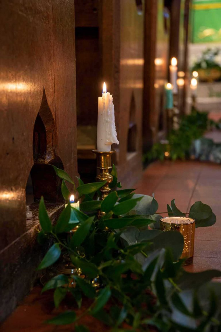 white candles and green foliage