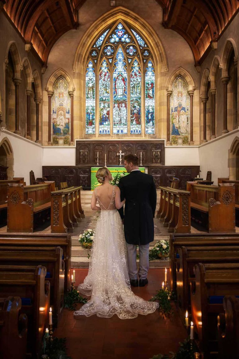 Bride and groom at the altar in Bradfield College chapel