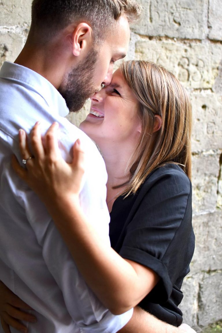 man kissing his fiances nose