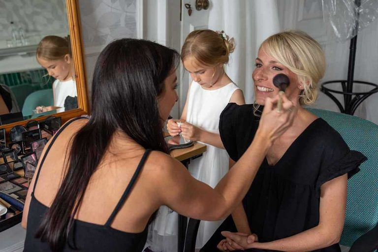 bride having her makeup done with a big brush