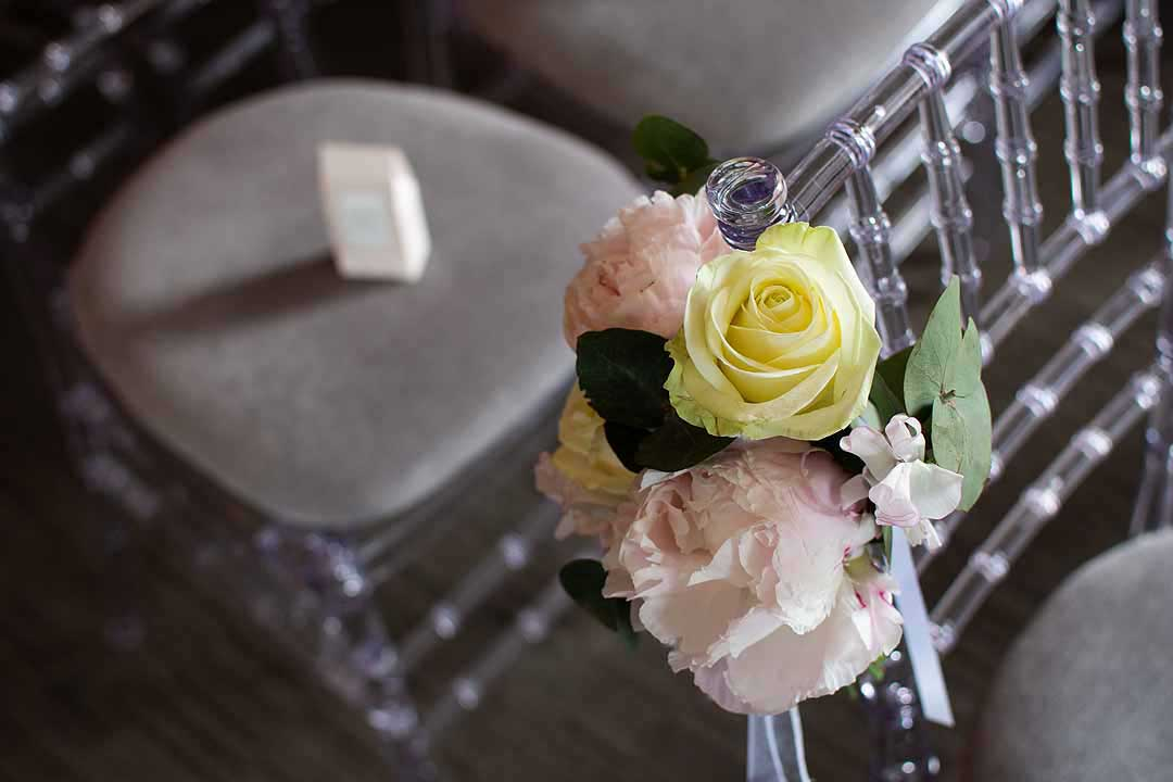 pink and yellow roses tied to a chair