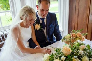Bride signing the marriage register