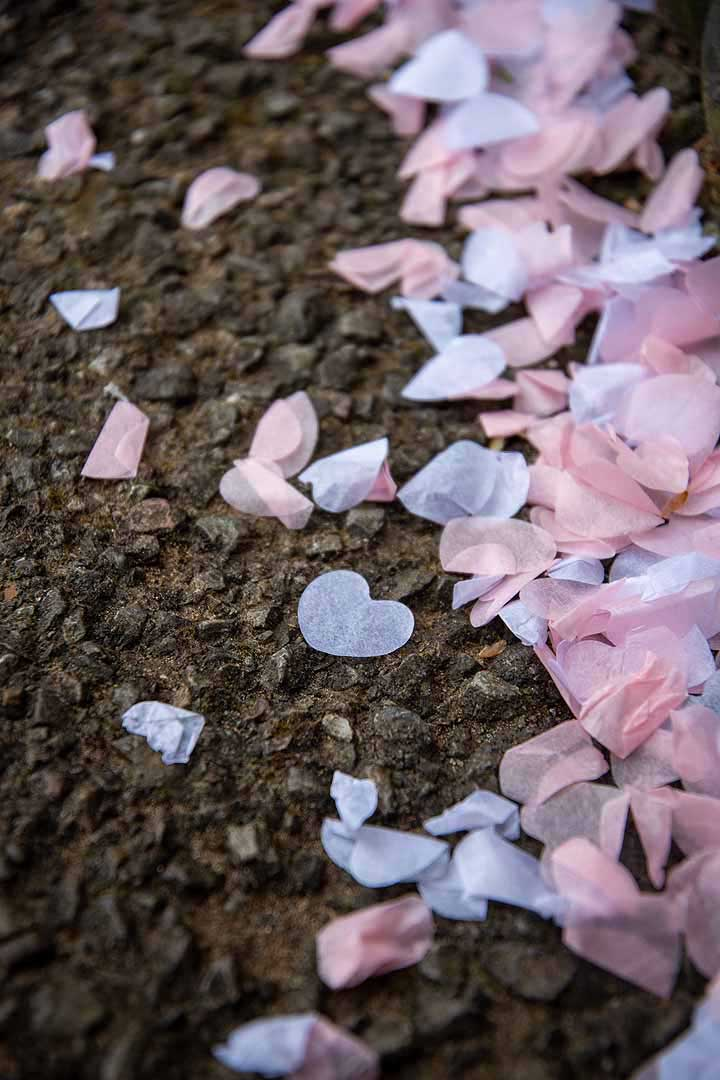 pink and white heart confetti on the ground