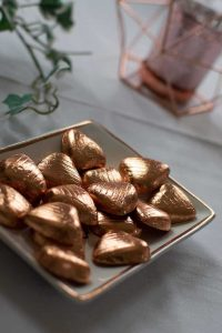 copper foil covered heart-shaped chocolates