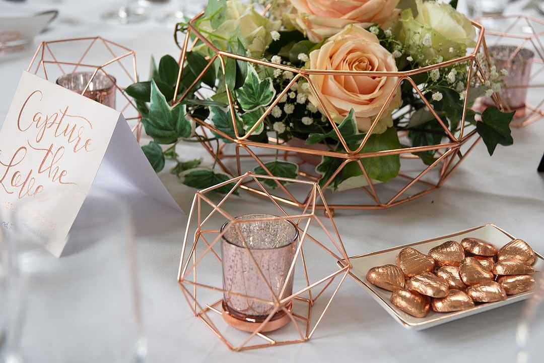 copper wedding table decorations and flowers