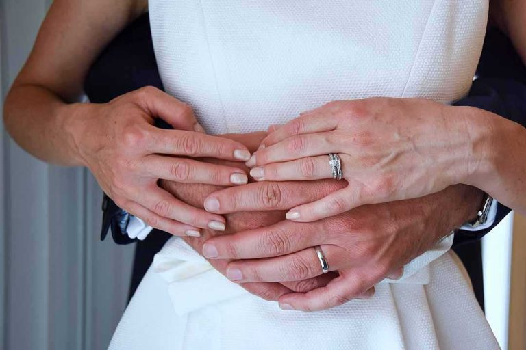 his and her hands showing wedding rings