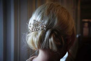 blond hair with copper and diamante hair slide