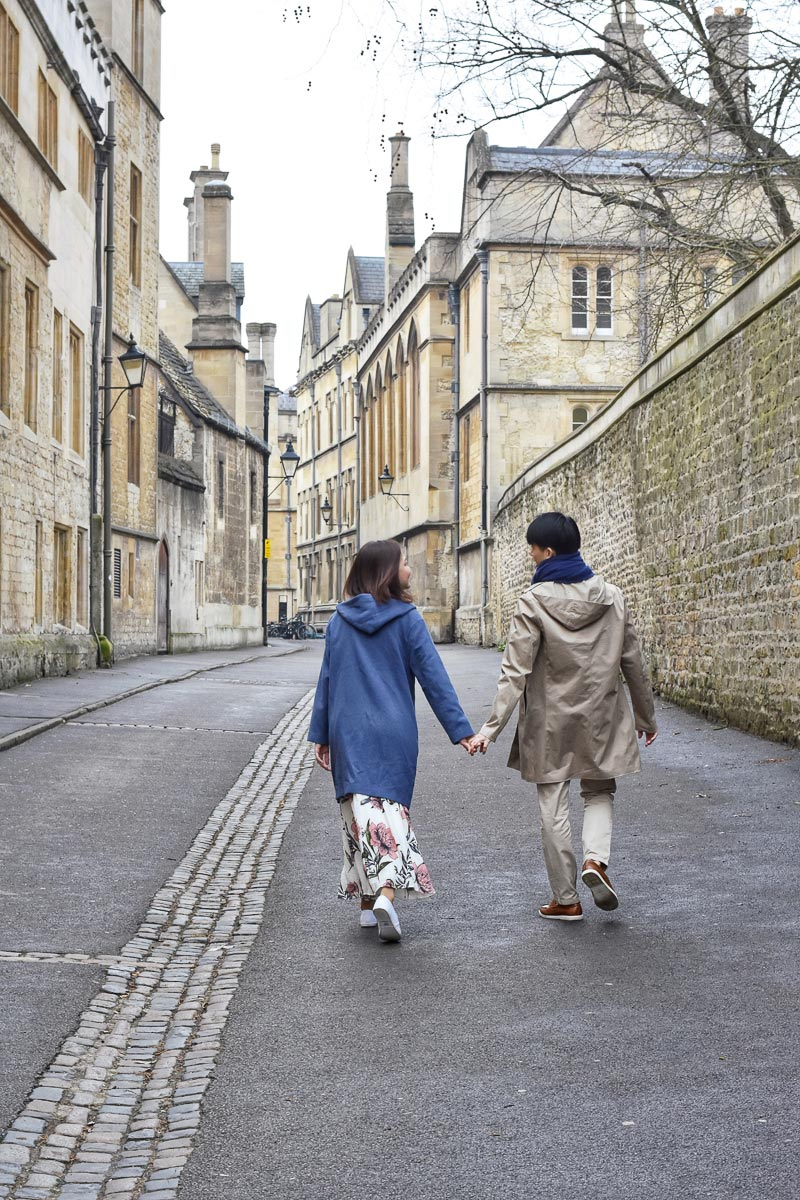 couple walking down brasenose lane oxford