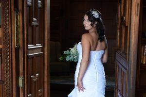 bride going through doors and looking back over her shoulder