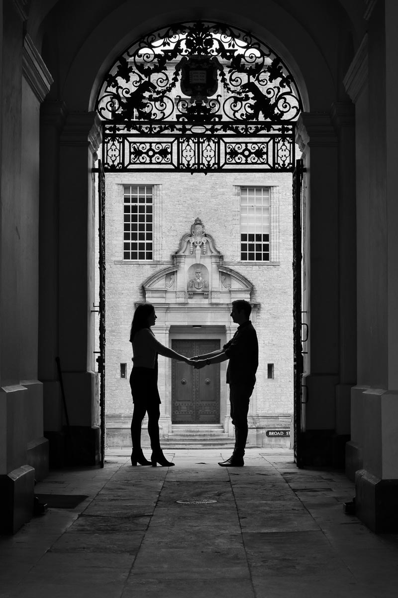man and women silhouetted in ornate doorway