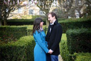 couple standing in gardens outside botanic gardens oxford