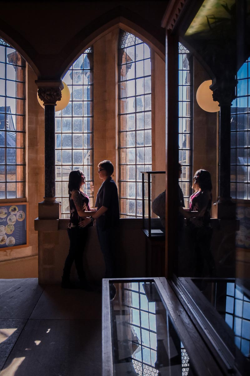 couple standing in window in natural history museum oxford