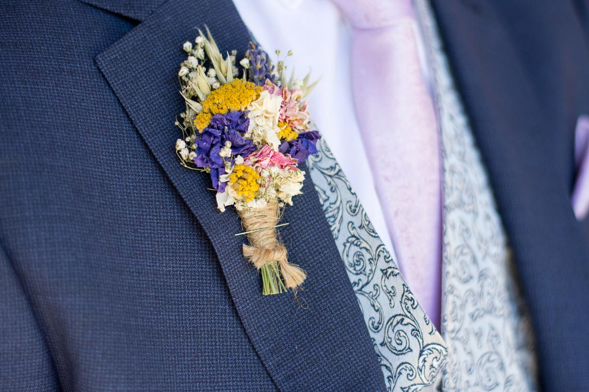 yellow white blue and pink dried flower buttonhole