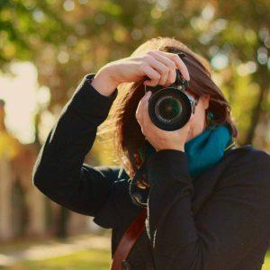 lorna holding a camera in autumn