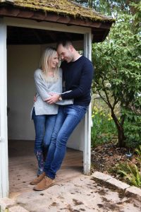 couple embracing in a pergola doorway