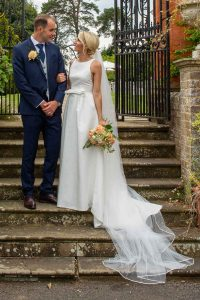 bride and groom together on garden steps