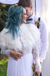 bride with blue hair and white fur cape
