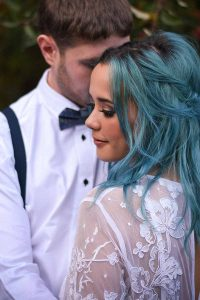 bride with blue hair looking round