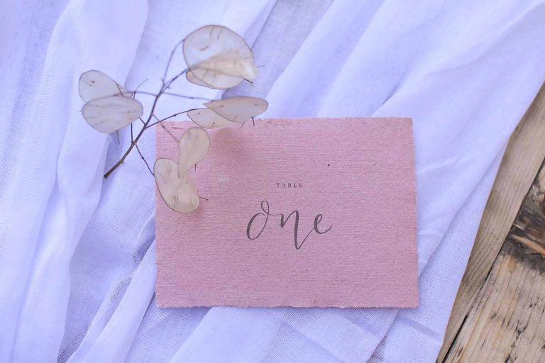 pink raw edged table name on white cloth