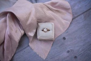 engagement ring in a velvet box with pink silk