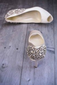 ivory peep toe shoes studded with diamonds on the heel