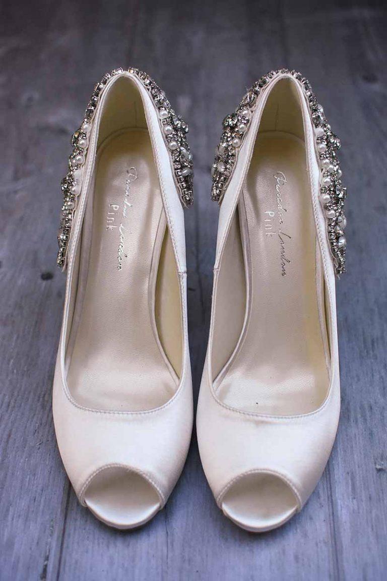 ivory peep toe shoes studded with diamonds on the heel