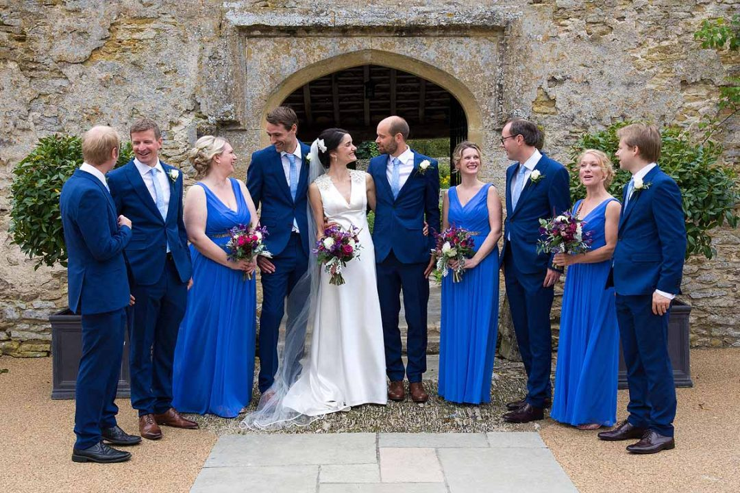 Wedding group photo with bride, groom, bridesmaids and groomsmen at Caswell House, Oxfordshire